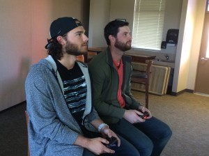 Brandon Crawford and Brandon Belt playing Madden NFL on Sony Playstation in Scottsdale Stadium