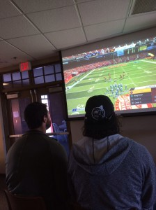 Brandon Belt and Brandon Crawford playing Madden NFL on Sony Playstation in Scottsdale Stadium